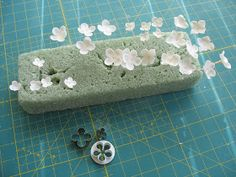 I made Dendrobium orchids and filler flowers all in white. I can get a bit carried away with making filler flowers making them as detailed a...