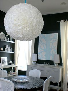 I love this HUGE Light! Made from a huge paper lantern and coffee filters! Super cheap but looks like a million dollars!
