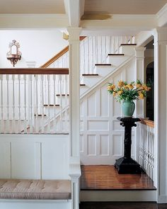The+woodwork+in+the+front+hall+and+stairwell+contrasted+sharply+with+the+dark-fir+floorboards.