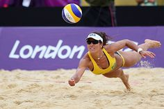 Get down Brazil's Maria Antonelli dives for a shot during the preliminary match against Germany.
