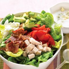 Cobb salad, a California classic, relies on high-quality produce. Look for tomatoes that are deep red and avocados that yield slightly when gently pressed.