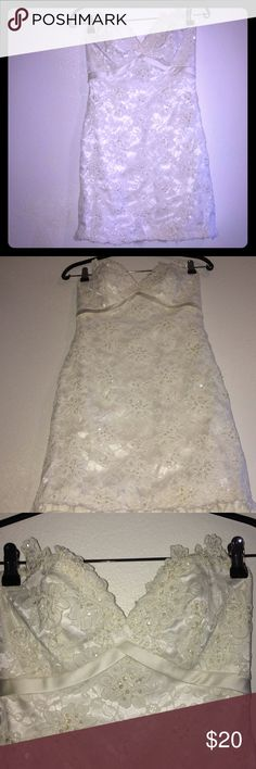"""modified David's Bridal Gown to mini formal dress modified David's Bridal Gown to mini formal dress, my sister did it.  This is definitely a must have dress when you want to look great at your ex's Wedding😂.  Modified & used in good condition, size 4. Approximate measurements W: 14""""inches L: 26""""inches.  $500 David's Bridal Dresses Wedding"""