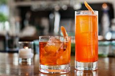 Two drinks made with Aperol: the Poolside Negroni, left, and Shaddock's Fizz. Photo: Lauren DeCicca for The New York Times