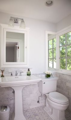 this tile adds a clean look to this white bathroom bathroom tile