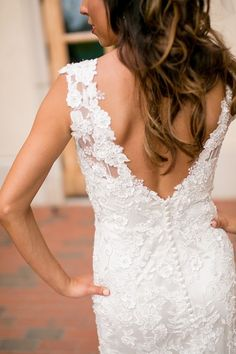 Sleeveless, fitted lace wedding dress with elegant V-back with buttons by @allurebridals  {Jeannine Marie Photography}