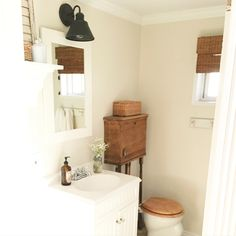 Our second bathroom in the tiny house. We did a few small upgrades but that antique toilet is my favorite part of this bathroom!   #farmhousebathroom #farmhousestyle #bathroomdecor #smallspace