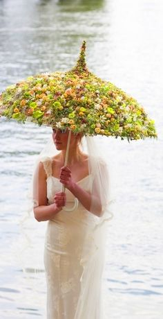 umbrella with arranged flowers - so cool!                                                                                                                                                                                 More