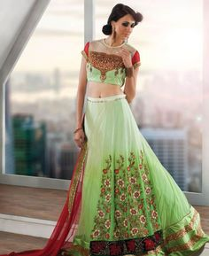 Buy Magnificent Light Green & Red Lehenga Choli online at  https://www.a1designerwear.com/magnificent-light-green-red-lehenga-choli  Price: $70.66 USD