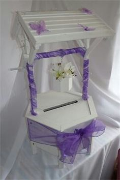 Wishing well to hire for weddings from www.rosiecarts.co.uk