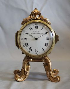 Antique English rococco style ormolu clock signed Dreyfus, Gilt Bronze Rococco style case withy four foliate legs   English   c.1905