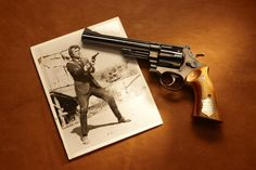 """SMITH  WESSON MODEL 29: This pistol was used by Clint Eastwood in Dirty Harry and Magnum Force (1972). It was a gift from Eastwood and Warner Brothers to film writer/director John Milius, who wrote significant parts of Dirty Harry and is credited with writing the screen play for Magnum Force. The pistol received notoriety as being the """"most powerful handgun in the world"""" and prompted civilian Model 29 purchases to skyrocket following the film's success."""