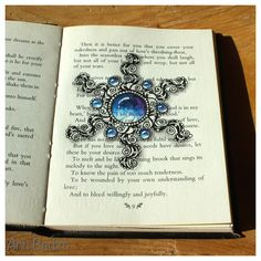 Old book, gemstone and # Camelia