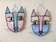 cats - cool use of old marbles for cat's eyes