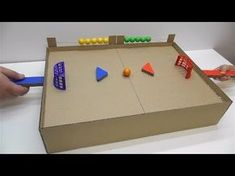 How to make a hockey with the ball with magnets Desktop Game from Cardboard - Kinderspiele Cardboard Box Crafts, Cardboard Toys, Paper Crafts, Diy For Kids, Crafts For Kids, Music Instruments Diy, Printable Bridal Shower Games, Diy Magnets, Hockey