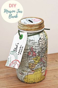 Saving money for your travels can be fun with a map Mason jar bank These gorgeous upcycled mason jars decoupaged with paper napkins would make a lovely gift for anyone with wanderlust maps masonjar decoupage modpodge masonjarbank # Wine Bottle Crafts, Mason Jar Crafts, Mason Jar Diy, Mason Jar Bank, Pot Mason, Upcycled Crafts, Diy Crafts, Sand Crafts, Preschool Crafts