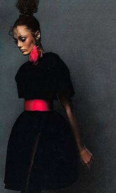 curly topknot, bubble skirt and hot pink sash (Guy Bourdin for Vogue Paris, 1973)