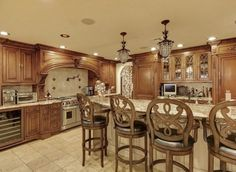 Pin for Later: Will Teresa and Joe Giudice's 10,000-Square-Foot Mansion Ever Find a Buyer?  The spacious kitchen includes an island with plenty of seating.