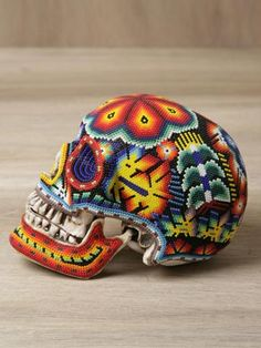 Our Exquisite Corpse worked with the Huichol people of Mexico to create these beaded skulls. Each beautifully patterned and brightly coloured skull features intricate craftsmanship and are uniquely different from one another.