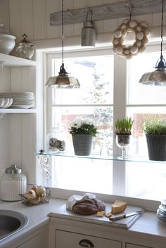 glass shelves for kitchen window  good way to add privacy and grow your own herbs and spices