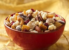 Holiday Caramel Chex® Mix ~ 4 cups popped microwave popcorn, 2 cups Corn Chex® cereal, 2 cups Rice Chex cereal, 1cup mixed nuts, 1/2cup butter, 3/4 cup packed brown sugar, 1/4cup light corn syrup, 1/2cup white vanilla baking chips, and 1/2 cup dried cranberries!