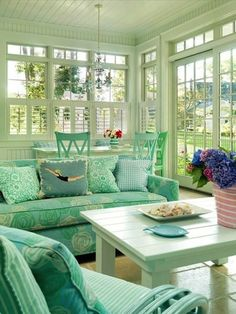 Cute #country #sunroom with sea foam green and white #furniture and potted flowers.