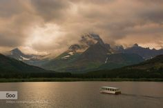 Last Boat of the Evening by phyllisplotkin  Glacier National Park Many Glacier Swift Current Lake boat clouds mountains sunset Last Boat of the