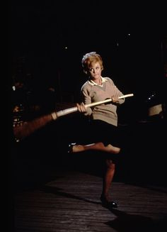 Miss Price dancing with a broom-Bedknobs and Broomsticks!