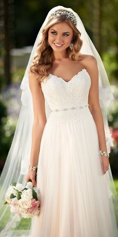 I really like this trend of lightly colored wedding dresses. Just a hint of color. So cute.