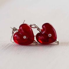 Perfect for Valentines Day, dainty red heart earrings. Handmade lampwork glass hearts set with cubic zirconias. I love the simplicity of these. Lampwork Earrings by Judith Johnston