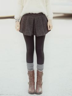 Oh my lovely. Fuzzy white sweater, pleated short skirt, black tights with grey socks and brown adventurous boots!!!! Ach ja!