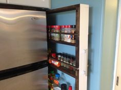 We decided our custom slide-out pantry should be exactly the height (and depth) of the fridge so it would hold as much as possible.