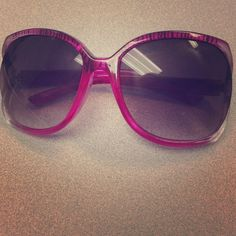 Pink tiger print sunglasses Hot pink with black stripes, these tiger print sunglasses with large frames are fun and a super cute look! Accessories Sunglasses