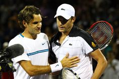 Roger Federer of Switzerland meets Andy Roddick of the USA at the net after losing to him during Day 8 at the #SEOpen in Biscayne FL    Al Bello - Getty Images