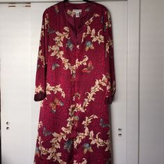 Morgan Taylor Lounging Robe This beautiful burgundy lounging robe has a lovely print and has beads around neck line. It has a zippered front and is made of 100% Polyester. This robe is in perfect never worn condition. You will look gorgeous in this! Morgan Taylor Intimates Intimates & Sleepwear Robes