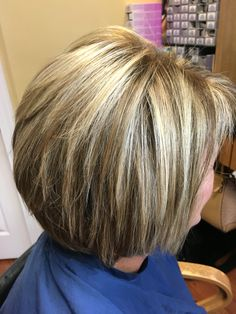 Blonde highlights and lowlights for this short hair cut and style making for a fun look!
