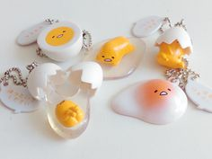 Ok, I'm a little bit in love with the Sanrio character Gudetama right now. He's a lazy, adorable egg yolk with a butt so how could anyone n. // I love Gudetama Cute Polymer Clay, Cute Clay, Polymer Clay Charms, Kawaii Shop, Kawaii Cute, Clay Crafts, Diy And Crafts, Balle Anti Stress, Lazy Egg