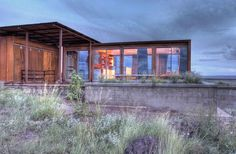 View of Marfa weeHouse Planters and Deck. Oxidizing steel paint on fiber cement board on the exterior.