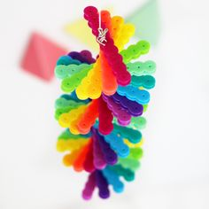 More DIYs if You're Bored Over the Summer - DIY Rainbow Wind Spinners made from Perler Beads | Karen Kavett