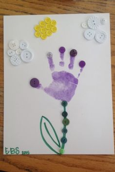Stamped handprint flower with button petals, clouds, and sun. All buttons were hot glued on. Cuteness!!