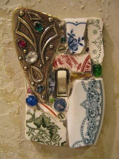 Mosaic Light Switch Plate: Save your old jewelry, beach glass, ceramics to make your own switch plates like these / http://johnrtitus.blogspot.ca/2013/01/save-your-old-jewelry-beach-glass.html
