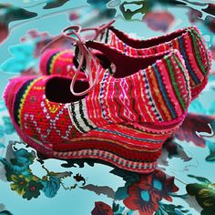 These handcrafted shoes incorporate quality embroidered textile using traditional artisan techniques of the Hmong tribe.