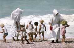 ITALY. 1958. Nuns with a class of children at the Adratic Sea near Cattolica.