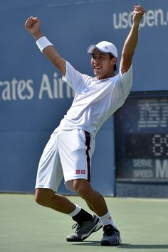 Kei Nishikori celebrates his US Open semifinal victory over Novak Djokovic. He becomes the first Asian man to reach a Grand Slam final.