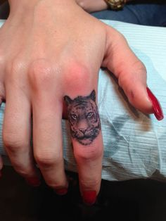 tiger finger tattoo, how cool maybe w a different animal thou