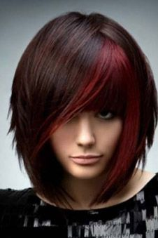 Adding a deep, bright red color to just the bangs and the front pieces of your dark brown hair frames your face and adds an instant pop to your hairstyle. This works best on blunt, edgy cuts
