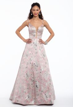 Be fierce and fancy in this ball gown dress! From the illusion plunge neckline and V-back to the triple beaded waist and ball gown skirt, this brocade long prom dress is a classy choice for your eventful evening. Complete the look with satin rhinestone sandals and a satin and glitter clutch. #CamilleLaVie
