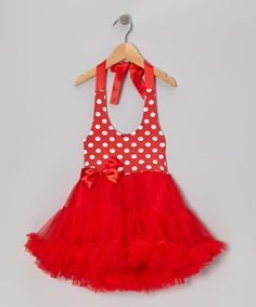 This fanciful dress is a must-have for any little make-believer. A soft, stretchy halter top provides a comfortable fit, while a poufy pettiskirt adds a wonderfully whimsical touch.