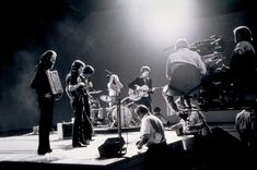 SWAN SONG<br> The Band (Garth Hudson, Levon Helm, Rick Danko, Richard Manuel, and Robbie Robertson), before the cameras for <em>The Last Waltz</em>, in 1976. From The Neal Peters Collection.