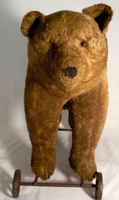 ANTIQUE STEIFF MOHAIR BEAR on CAST IRON WHEELS CIRCA 1910