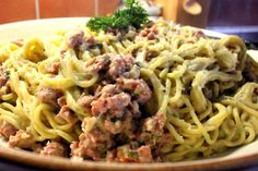 Parsley Pasta with a Sausage Sauce cooked in beer